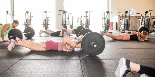 Fit_people_doing_crossfit_wokrout_with_barbells_and_burpees.jpg