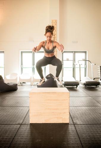 Fit_woman_performing_box_jumps_cardio_training.jpg